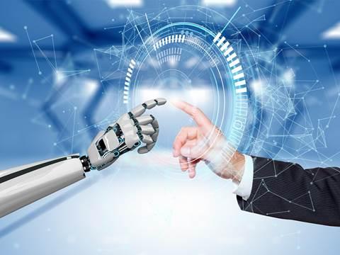 En robotarm som möter en kavajklädd arm pekfinger mot pekfinger.